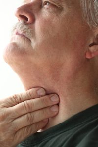 30812082 - older man has a problem with swallowing or a sore throat